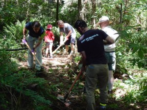 Volunteers getting dirty on the new trail on May 30.